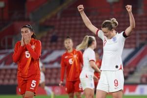 North Macedonia's Pavlinka Nikolovska looks dejected as England's Ellen White celebrates after England's third goal, an own goal scored by Julija Zivikj.