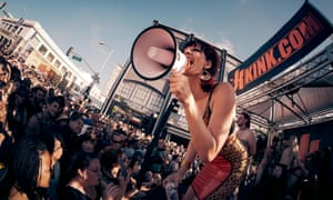 Mrs Madeline working the crowd at Folsom Street Fair in San Francisco, California.