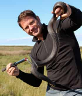 Steve Backshall with a highly venomous copperhead snake, in a still from the TV series Deadly 60