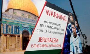 A poster in the West Bank town of Hebron featuring Lionel Messi criticises the friendly between Israel and Argentina which was to be held in Jerusalem on Saturday