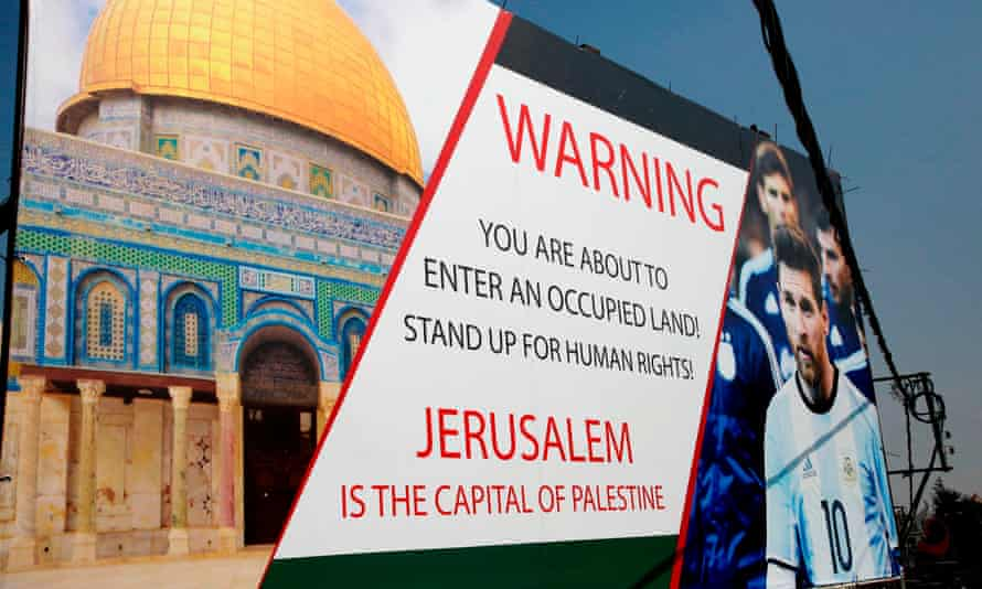 PALESTINIAN-ISRAEL-FBL-ARGENTINA-CONFLICTA picture taken on June 5, 2018, shows a poster erected on a main street in the West Bank town of Hebron, denouncing the upcoming friendly football match between Argentina and Israel and calling Argentina's star Lionel Messi (portrait) to boycott the match. Palestinian football boss Jibril Rajoub, on June 3, called on Barcelona star Lionel Messi not to play in the Argentina-Israel game that is scheduled to take place in Jerusalem on June 9 and urged fans to burn their shirts if he does. / AFP PHOTO / HAZEM BADERHAZEM BADER/AFP/Getty Images
