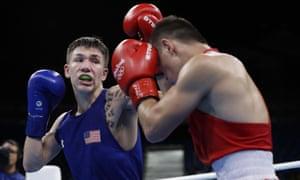 Nico Miguel Hernandez, left, fights Uzbekistan's Hasanboy Dusmatov in the semi-final.