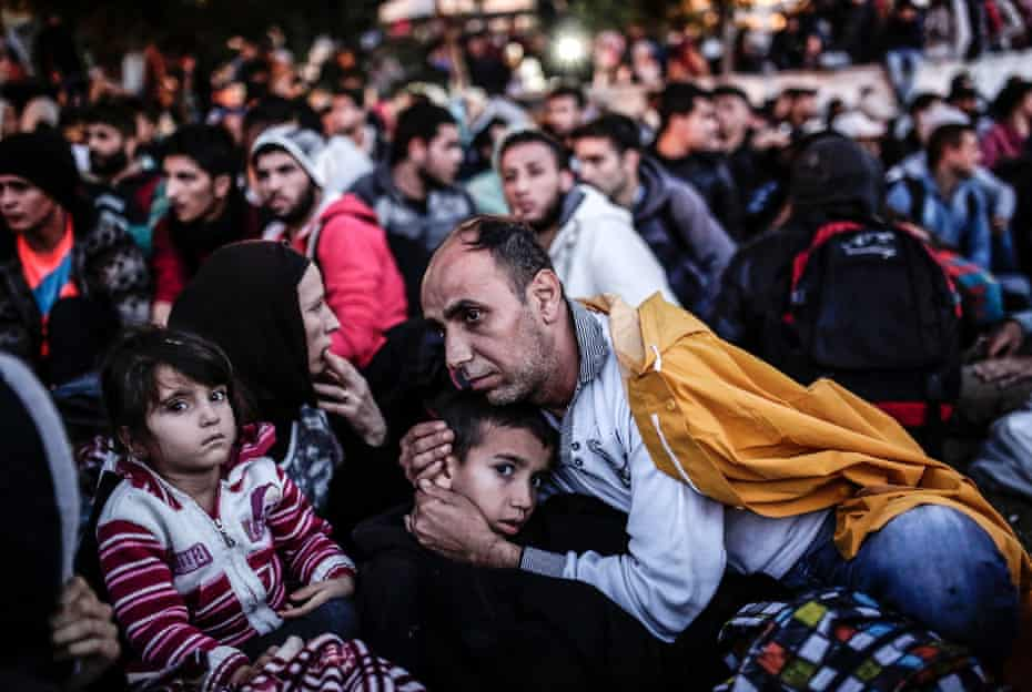 Migrants and refugees wait at Istanbul's Esenler Bus Terminal for buses to the Turkish-Greek border