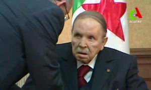 A screengrab from footage broadcast by Algerian TV shows Abdelaziz Bouteflika meeting with members of his government in the capital, Algiers, on 11 March.