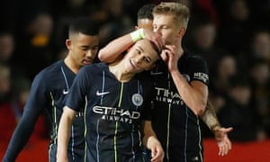 Phil Foden is congratulated by Oleksandr Zinchenko after scoring his second and Manchester City's third