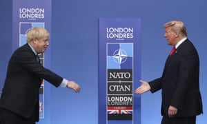 Boris Johnson reaches out to shake hands with Donald Trump before a Nato leaders' meeting in Watford, December 2019.