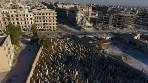 Drone footage shows a cemetery surrounded by damaged buildings in a rebel-held area of Aleppo