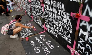 Performance in Protest against Gender Violence, Mexico City, Mexico - 07 Mar 2021<br>Mandatory Credit: Photo by Luis Barron/Eyepix Group/Pacific Press/REX/Shutterstock (11790309f) A woman, takes part during a performance of Feminist groups, to write names of victims of femicide and place flowers in protest against gender violence, as part of the protests of International Women's Day at the National Palace. Performance in Protest against Gender Violence, Mexico City, Mexico - 07 Mar 2021