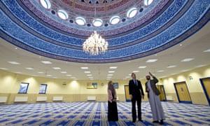 David Cameron talks with Imam Qari Asim (righ), and Shabana Muneer, a member of Makkah Masjid mosque's women's group, as he visits Makkah Masjid Mosque in Leeds