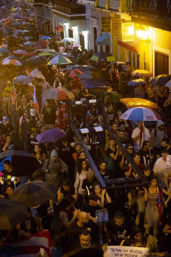 Protestors carried a guillotine aloft as they marched in Old San Juan on 23 January.