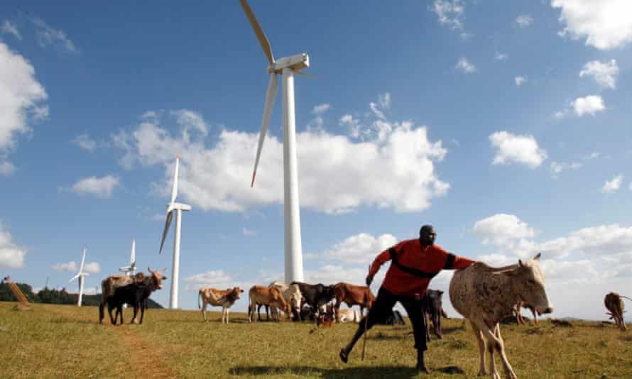 A Masaai herdsman looks after his cattle near the power-generating wind turbines at the Kenya Electricity Generating Company (KenGen) station in Ngong hills, 22 km (13.7 miles) southwest of Kenya's capital Nairobi, July 17, 2009.