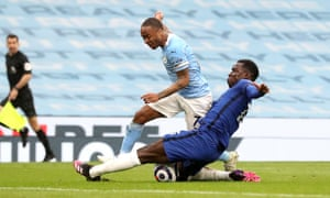 Manchester City's Raheem Sterling (left) shot is blocked by Chelsea's Kurt Zouma.