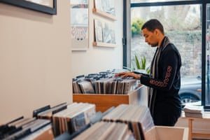 Musician Batu browses records at Idle Hands record shop in Bristol, England. Independent shops like these are worried about the impact of Brexit.