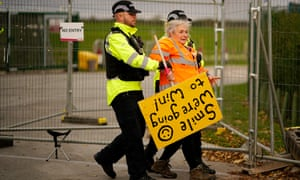 Police officers remove an anti-fracking protester at the Preston New Road site where Cuadrilla has recommenced fracking operations