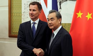 Jeremy Hunt shakes hands with China's foreign minister Wang Yi before their meeting at the Diaoyutai State Guesthouse in Beijing