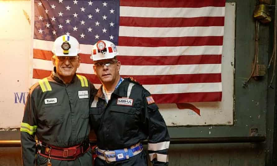 Joe Manchin (left) poses with Labor Secretary Marty Walsh in August, during a tour of a coal mine in Dallas, West Virginia.