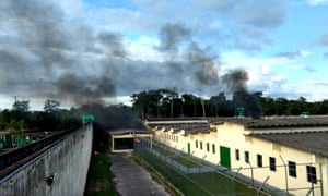 Smoke rises from the Anísio Jobim prison complex during a riot, in Manaus.