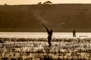 A hunter fires at ducks at Little Lake Buloke during this season's opening morning