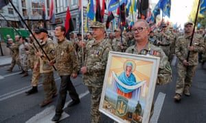 Ukrainian servicemen from volunteer units take part in the march