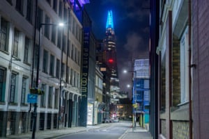 The top 15 levels of The Shard skyscraper shine blue in support of the NHS in London