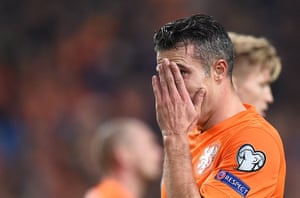 Robin van Persie reacts after scoring at the wrong end.