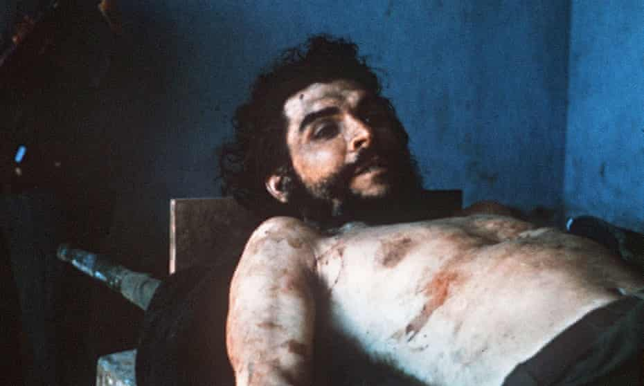 In a picture taken on 10 October 1967 by AFP journalist Marc Hutten of the body of Argentina-born guerrilla leader Ernesto 'Che' Guevara is exposed on a laundry sink in the village of Valle Grande, Bolivia.