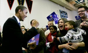 Then senator Barack Obama dances with a baby boy and his mother as he arrives at a campaign stop at Central Middle School in Waterloo, Iowa, in 2007.