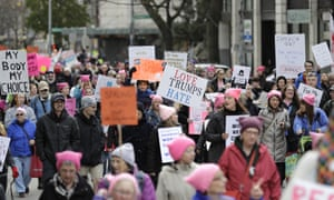 Participants in the Women's March in Seattle, march through downtown, Saturday, Jan. 19, 2019. Cities big and small across the Pacific Northwest held versions or multiple versions of the Women's March over the weekend, mirroring a national march in Washington, DC. (AP Photo/Ted S. Warren)