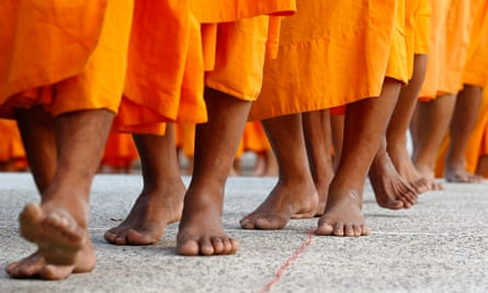 Thai Buddhist monks on their way to the morning alms offering ceremony.