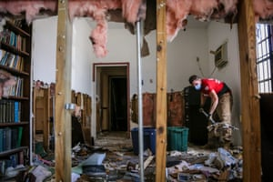 sChristopher Mackay, of Sheep Dog Impact Assistance, cleans debris from a church in the aftermath of Hurricane Dorian and Tropical Storm Humberto, in Grand Bahama, Bahama
