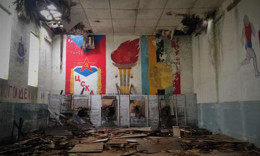 One of the school gyms featuring Soviet murals on its walls.