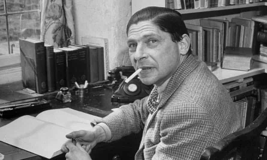 Arthur Koestler working in his study.