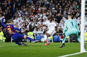 Real Madrid's Vinicius Junior scores his side's opening goal past Barcelona's goalkeeper Marc-Andre ter Stegen.