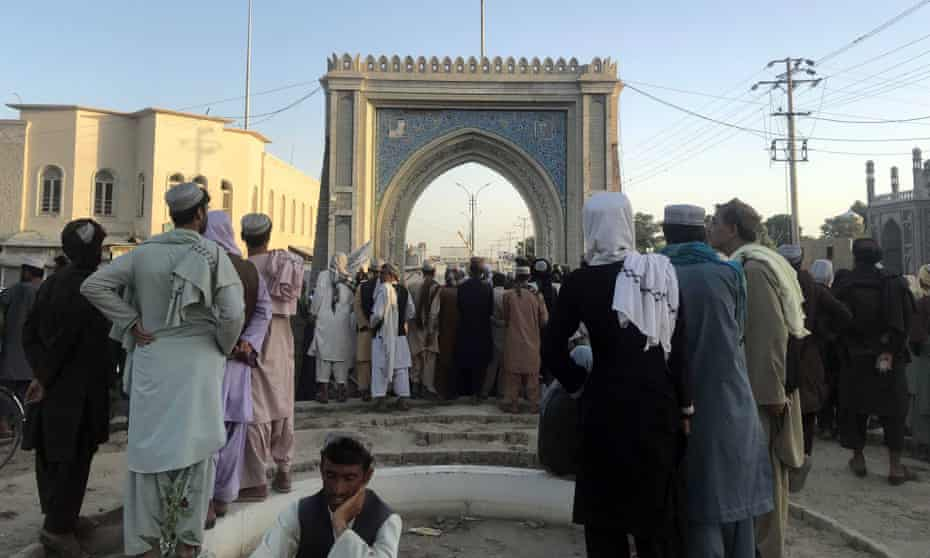 The Taliban flag flies in Kandahar after the city fell on Friday