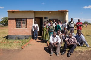 Teachers and parents outside the Dr David Montefiore Memorial Library in Mguwata, Malawi