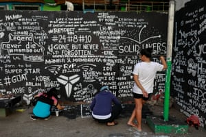 Fans write messages on the basketball court of a housing tenement in Taguig City, Manila.