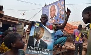Campaign posters of Central African Republic presidential candidates Faustin-Archange Touadéra, above, and Anicet-Georges Dologuélé are covering the streets of the capital Bangui before Sunday's election.