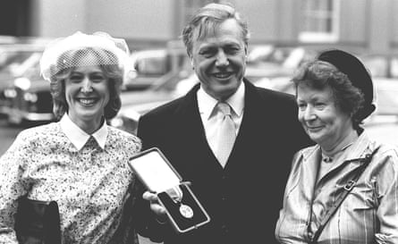 Sir David Attenborough who was knighted by the Queen at an investiture at Buckingham Palace, London, with his wife Jane (right) and daughter Susan.