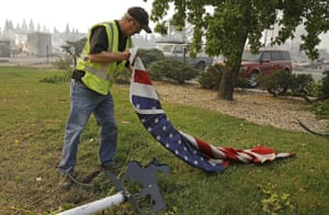 Man picks up a US flag