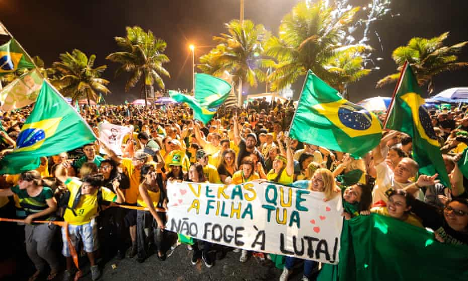 Supporters Jair Bolsonaro celebrate in Rio de Janeiro after he won Brazil's presidential election on 28 October.