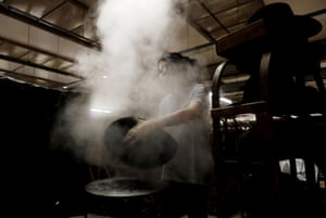 Steam is used to mould a fur hat.