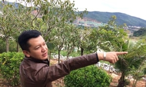 Li Yanjun, a budding Jinghong estate agent, says his city is booming as developers pour in.