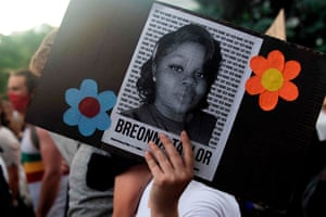 A demonstrator holds a sign with a photo of Breonna Taylor in Denver, Colorado, on 3 June.