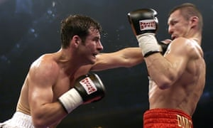 Joe Calzaghe of Wales lands his left glove on Mario Veit of Germany and goes on to win the WBO Super Middleweight world title fight in Braunschweig 07 May 2005.