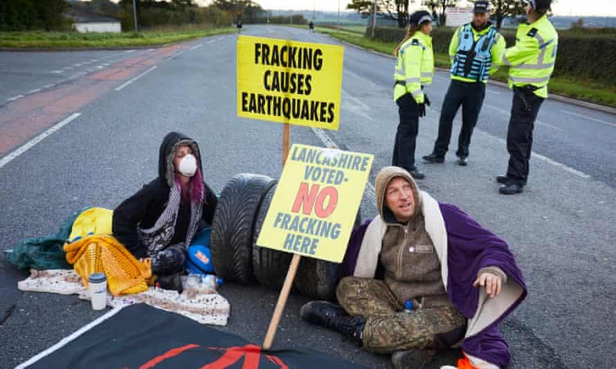 Protesters block the road outside Cuadrilla's Preston New Road site in Lancashire