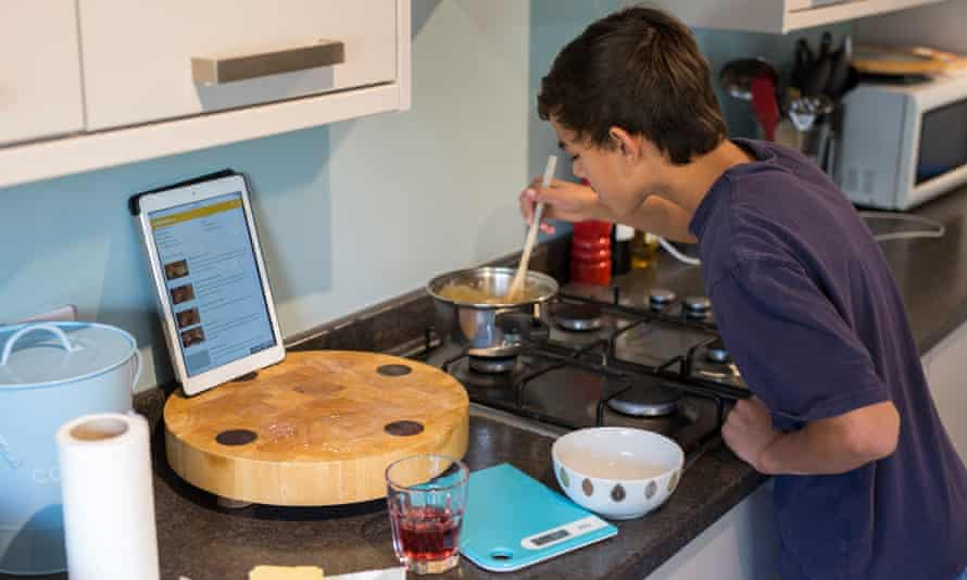 Josiah baking in kitchen