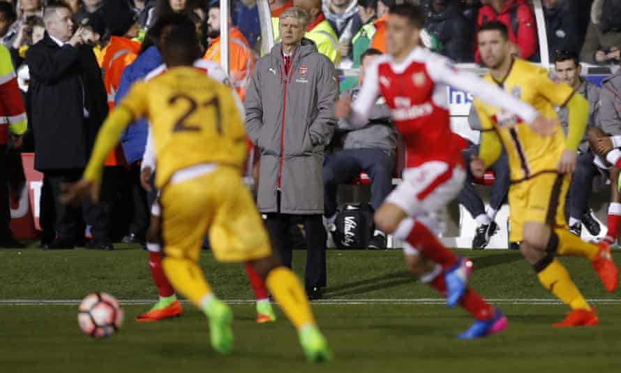 Arsène Wenger watches on during Arsenal's win at Sutton.