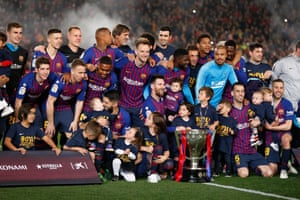 Barcelona players celebrate their title win.