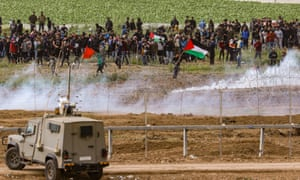Palestinian protesters from Gaza strip clash with Israeli soldiers at the security fence next to Nahal Oz, on March 30, 2019