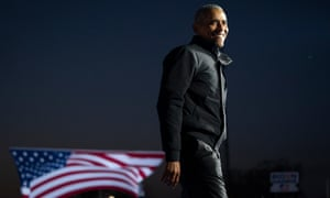 Barack Obama speaks during a drive-in campaign rally with Democratic presidential nominee Joe Biden at Belle Isle on 31 October in Detroit, Michigan.